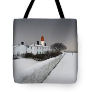 A Snow Covered Fence With A Lighthouse Tote Bag by John Short