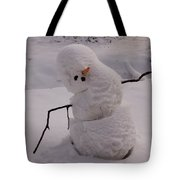 A Snowman Sitting In The Snow Tote Bag