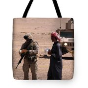 A Soldier Communicates With A Local Tote Bag