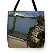 A Soldier Patrols The Streets Of Qalat Tote Bag