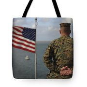 A Soldier Stands At Attention On Uss Tote Bag