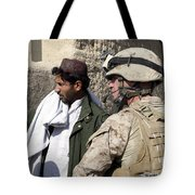 A Soldier Talks To A Local Villager Tote Bag