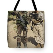 A Spanish Marine Points Out An Tote Bag