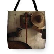 A Straw Hat, Straw Baskets And A Belt Tote Bag