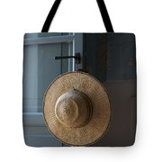 A Sun Hat Hangs On The Door Of A Tuscan Tote Bag