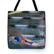 A Swimmer Races Through The Water Tote Bag