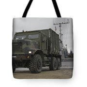 A Tactical Vehicle Is Off-loaded Tote Bag
