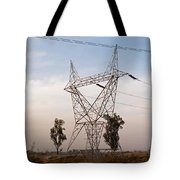 A Transmission Tower Carrying Electric Lines In The Countryside Tote Bag