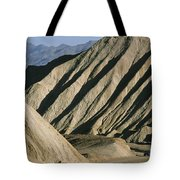 A Truck Is Dwarfed By Eroded Desert Tote Bag