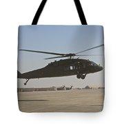 A Uh-60 Black Hawk Landing Tote Bag