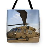 A Uh-60 Black Hawk Parked At A Military Tote Bag