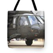 A Uh-60 Black Hawk Taxis Tote Bag