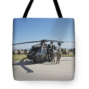A Uh-60l Blackhawk Parked On Its Pad Tote Bag