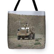A U.s. Army Cougar Patrols A Wadi Tote Bag