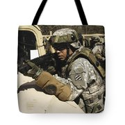 A U.s. Army Soldier Pulls Security Tote Bag