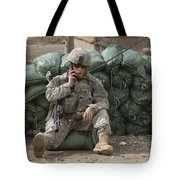 A U.s. Army Soldier Talks On A Radio Tote Bag