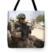 A U.s. Marine Gives A Piece Of Candy Tote Bag