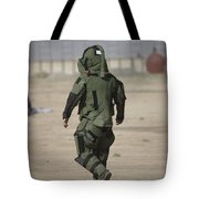 A U.s. Marine Tries Running In A Bomb Tote Bag