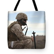 A U.s. Marine Uses A Field Phone Tote Bag