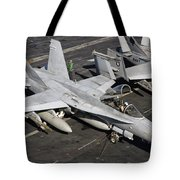 A Us Navy Fa-18c Hornet Parked Tote Bag