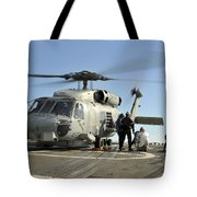 A U.s. Navy Sh-60b Seahawk Helicopter Tote Bag
