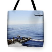 A U.s. Navy Uh-1n Huey Helicopter Tote Bag