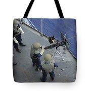A U.s. Sailor Fires A .50-caliber M2hb Tote Bag