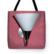 A Wall Mounted Lamp Set Against A Pink Printed Wall Color Tote Bag