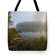 A Weathered Rowboat On The Shore Tote Bag