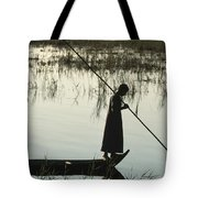 A Woman Stands At The End Of A Rowboat Tote Bag