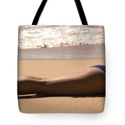 A Woman Sunbathes On The Beach Tote Bag