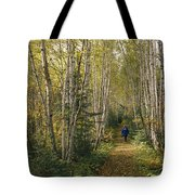 A Woman Walks Down A Birch Tree-lined Tote Bag