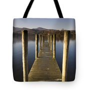 A Wooden Dock Going Into The Lake Tote Bag