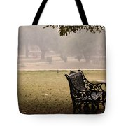 A Wrought Iron Black Metal Bench Under A Tree In The Qutub Minar Compound Tote Bag