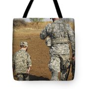 A Young Boy Joins His Squad Leader Tote Bag