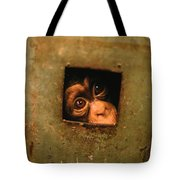 A Young Chimpanzee Held Captive Tote Bag