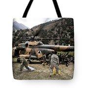 Afghan National Army Soldiers Unload Tote Bag
