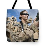 Air Force Captain Looks At A Defense Tote Bag