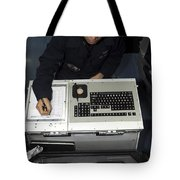 Air Traffic Controller Records Incoming Tote Bag