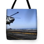 Airman Directs An Eh-101 Merlin Tote Bag