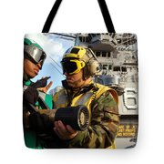 Airman Receives Proper Fire Fighting Tote Bag