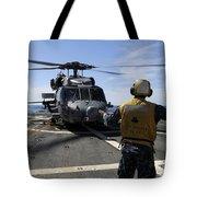 Airman Signals To An Mh-60s Sea Hawk Tote Bag