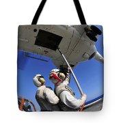 Airmen Attach Pallet Rigs To An Sa-330j Tote Bag