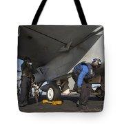 Airmen Chain Down An Fa-18e Super Tote Bag