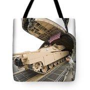 Airmen Load A Tank Into A C-5m Super Tote Bag