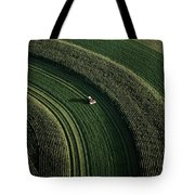An Aerial View Of A Tractor On Curved Tote Bag