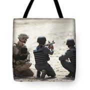 An Afghan Police Student Prepares Tote Bag