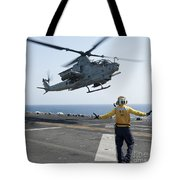 An Ah-1z Cobra Helicopter Takes Tote Bag