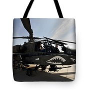 An Ah-64d Apache Helicopter Parked Tote Bag