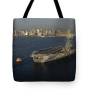 An Aircraft Carrier With The Skyline Tote Bag